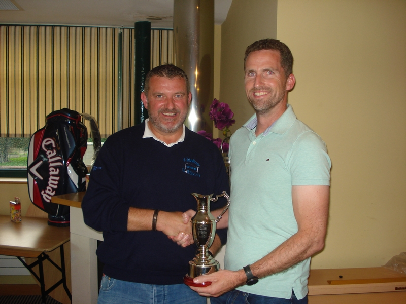 Captains winner Alan McNally (right) with Captain John O'Connor presenting.